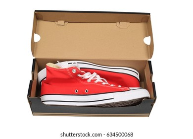 Rad canvas sneakers in a box, isolated with clipping path