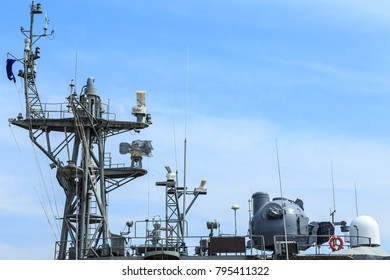 Radar of warship at the harbor in Thailand on blue sky background