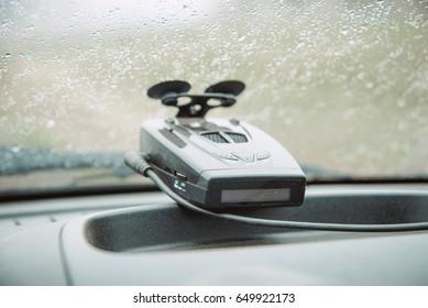 radar-revolutionary on the glass of the car, radar detector