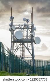 Radars and antennas on a mountain Gabriel. Ireland.