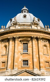 The Radcliffe Camera reading room of Oxford University's Bodleian Library against a deep blue sky