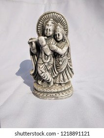 radha Krishna idol ancient look sculptured statue gray colored beautiful indian god and godess.