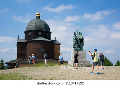 RADHOST HILL, BESKIDS MOUNTAINS, CZECH REPUBLIC / CZECHIA – JUNE 20, 2018: School trip - tourists are on the trip to see landmark and monument