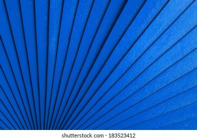 Radial abstract background with blue wooden stripes