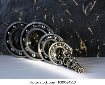 radial bearings on a black wall background