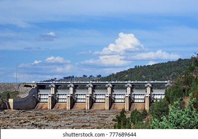 Radial Spillway gates of Wyangala Dam at the junction of the Lachlan and Abercrombie Rivers, central west region, NSW, Australia. Built for flood mitigation, hydro electricity and irrigation.