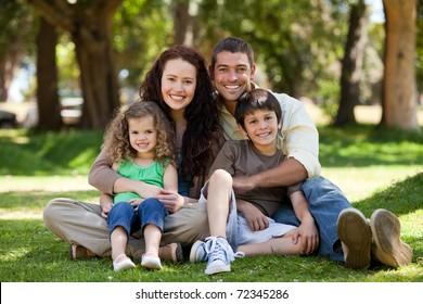 Radiant family sitting in the garden