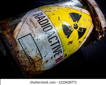 Radiation warning sign on transport index label stick on the rust and decay radioactive material container