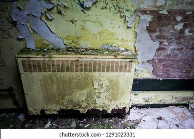 Radiator at an abandoned and derelict lunatic asylum/hospital (now demolished), Cane Hill, Coulsdon, Surrey, England, UK