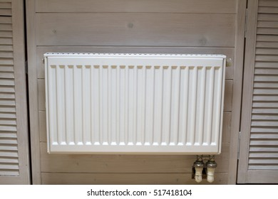 radiator battery white wooden walls attic
