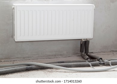 radiator with piped heating pipes in a new apartment under construction