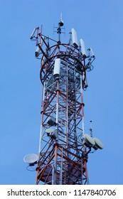 Radio broadcast tower, wireless communication antenna on blue background.