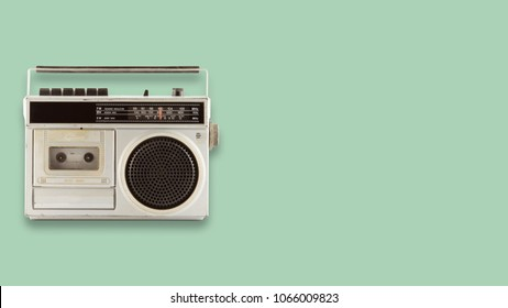 Radio cassette recorder and player on color background. retro technology. flat lay, top view hero header. vintage color styles.