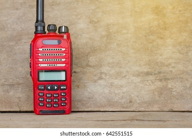 Radio communication color red on the wood background.