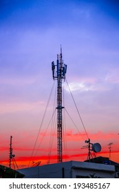 A radio communications tower in twilight time