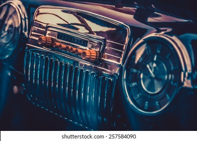 Radio in dashboard in interior of old vintage automobile. Processed by vintage or retro effect filter