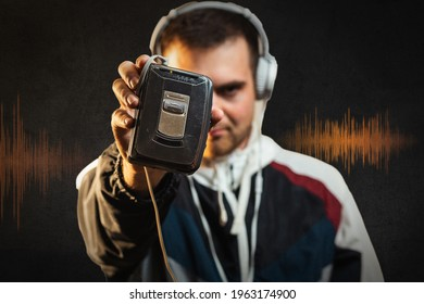Radio day. Man listening music in headphones. Oldschool cassette player. Inspiring song. Music library. Feel rhythm. Bearded guy enjoy music. Equalizer player settings. Lifestyle music fan. Hipster