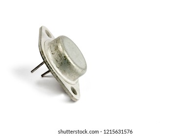Radio element, a very old diode close-up, on a white background.