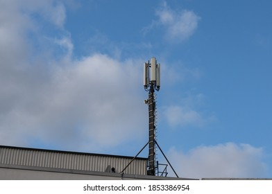 Radio mast, directional radio and mobile phone mast antenna system G5 network technology on a residential building