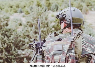 Radio operator soldier, voices pack portable transceiver back view