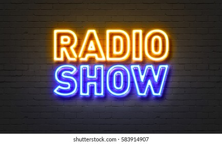Radio show neon sign on brick wall background