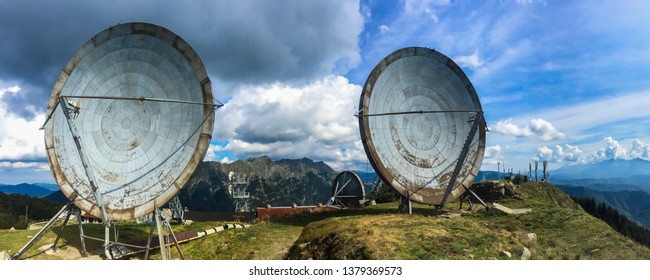 Radio station of NATO, abandoned in 70s, used during cold war.  Big parabolic antenna. Monte Giogo, Tuscany, Italy.