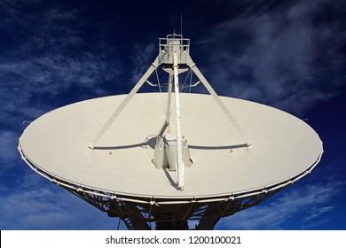 a radio telescope in a giant dish antenna at the karl g. jansky very large array radio astronomy observatory  near socorro, new mexico