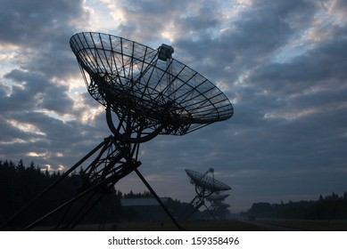 Radio Telescopes at foggy sunset  in Westerbork, the Netherlands