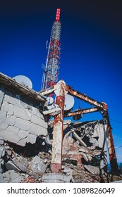 Radio or television antenna being destroyed due to war time or bombing. metal construction destroyed due to war time