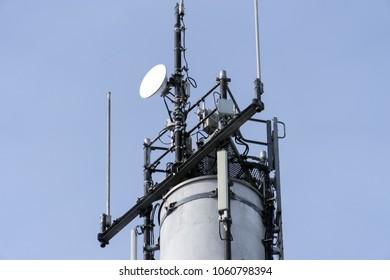 Radio tower with antennas over blue sky