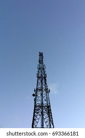 Radio Transmitter Silhouette in Clear Blue Sky Background