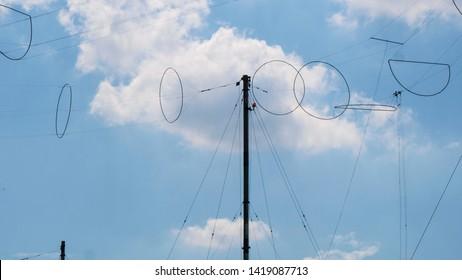 Radio transmitting station on the blu sky background.military telecommunication towers.