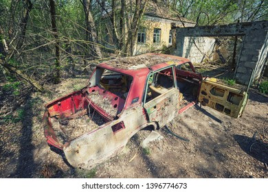 Radioactive dead zone of Chernobyl. Abandoned looted appliances, cars, electronics in Chernobyl accident. Consequences of evacuation, looting and vandalism after an explosion