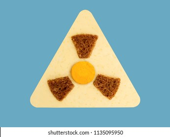 Radioactive radiation danger symbol with yellow and black stripes made from food, unsafe food