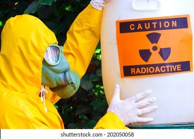 Radioactive waste ; Chemist in protective suit the disposal of radio active waste,photography