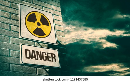 Radioactivity and chemical hazard street sign with toxic clouds on the background: pollution and danger concept