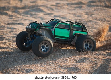 Radio-controlled car movement on the sand.