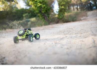 Radio-controlled car on the sand. In race.
