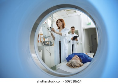 Radiologic technician and Patient being scanned and diagnosed on