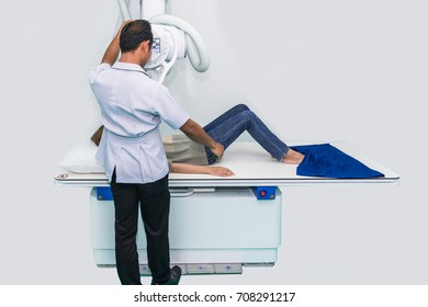 radiologist ready to take x-ray of patient