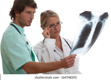 Radiologist showing x-ray of patient with sick lungs to another specialist