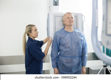Radiologist Taking Xray Of Male Patient In Hospital