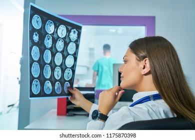 Radiologist woman checking x-ray, health care, medical and radiology concept