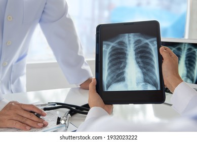 radiology and medicine concept. doctor explaining the results of scan lung on digital tablet screen to patient.