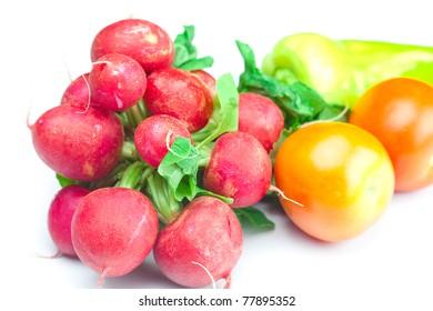 radish, tomato and pepper isolated on white