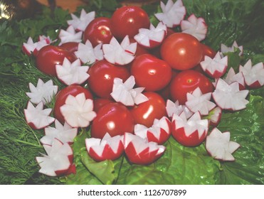 Radish and tomatoes in greenery