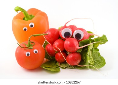 Radishes,a tomato and an orange bell pepper with googly eyes sit on a white background.