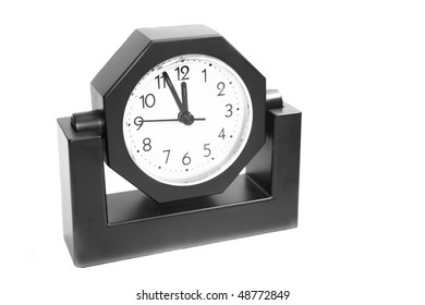 raditional alarm clock on white background.