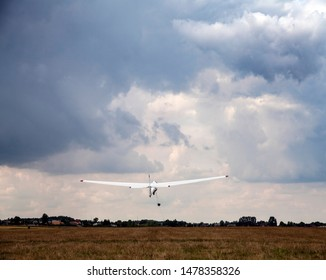 Radom, Airklub, Poland/August 3, 2019; Glider at the airport. Winch launching a glider. Starting glider.