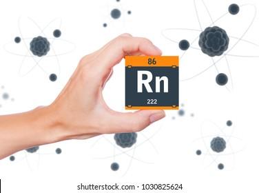 Radon element symbol handheld and atoms floating in background